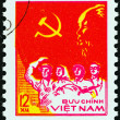 "VIETNAM - CIRCA 1978: A stamp printed in North Vietnam from the ""33rd Anniversary of Proclamation of Vietnam Democratic Republic "" issue shows Worker, Peasant, Soldier and Intellectual, circa 1978. — Stock Photo #44250249"