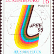 """LUXEMBOURG - CIRCA 1995: A stamp printed in Luxembourg from the """"Anniversaries and Event"""" issue shows Emblem of 6th Small European States Games, Luxembourg, circa 1995. — Stock Photo"""