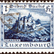 LUXEMBOURG - CIRCA 1921: A stamp printed in Luxembourg shows Vianden Castle, circa 1921. — Stock Photo