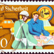 "GERMAN DEMOCRATIC REPUBLIC - CIRCA 1975: A stamp printed in Germany from the ""Road Safety"" issue shows Policeman assisting motorist, circa 1975. — Stock Photo"