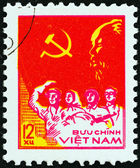 "VIETNAM - CIRCA 1978: A stamp printed in North Vietnam from the ""33rd Anniversary of Proclamation of Vietnam Democratic Republic "" issue shows Worker, Peasant, Soldier and Intellectual, circa 1978. — Stock Photo"