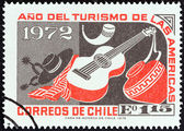"CHILE - CIRCA 1972: A stamp printed in Chile from the ""Tourist Year of the Americas"" issue shows Folklore and Handicrafts, circa 1972. — Stock Photo"