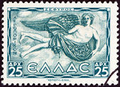 "GREECE - CIRCA 1943: A stamp printed in Greece from the ""Airmail - Greek Mythology. Winds "" issue shows Zephyr (West wind), circa 1943. — Stock Photo"