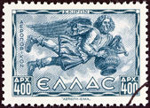 "GREECE - CIRCA 1943: A stamp printed in Greece from the ""Airmail - Greek Mythology. Winds "" issue shows Skiron (North-west wind), circa 1943. — Stock Photo"