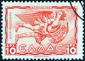 "GREECE - CIRCA 1943: A stamp printed in Greece from the ""Airmail - Greek Mythology. Winds "" issue shows Apiliotis (East wind), circa 1943. — Stock Photo"