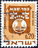"ISRAEL - CIRCA 1969: A stamp printed in Israel from the ""Civic Arms (2nd series)"" issue shows coat of Arms of Kefar Sava, circa 1969. — Stock Photo"