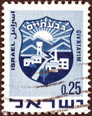 "ISRAEL - CIRCA 1969: A stamp printed in Israel from the ""Civic Arms (2nd series)"" issue shows coat of arms of Giv'atayim, circa 1969. — Stock Photo"