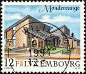 "LUXEMBOURG - CIRCA 1990: A stamp printed in Luxembourg from the ""Tourism"" issue shows Mondercange administrative offices, circa 1990. — 图库照片"