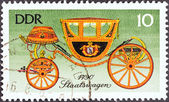 "GERMAN DEMOCRATIC REPUBLIC - CIRCA 1976: A stamp printed in Germany from the ""19th-century Horse-drawn Vehicles"" issue shows State Carriage, 1790, circa 1976. — Stock Photo"