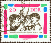 """GERMAN DEMOCRATIC REPUBLIC - CIRCA 1964: A stamp printed in Germany from the """"German Youth Meeting, Berlin"""" issue shows Young gymnasts, circa 1964. — Stock Photo"""