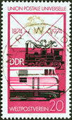 "GERMAN DEMOCRATIC REPUBLIC - CIRCA 1974: A stamp printed in Germany from the ""Centenary of U.P.U"" issue shows Steam and diesel railway locomotives, circa 1974. — Stock Photo"