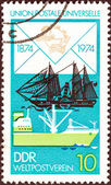 "GERMAN DEMOCRATIC REPUBLIC - CIRCA 1974: A stamp printed in Germany from the ""Centenary of U.P.U"" issue shows James Watt (paddle steamer) and Modern Freighter, circa 1974. — Stock Photo"