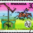 "RWANDA - CIRCA 1977: A stamp printed in Rwanda from the ""World Telecommunications Day "" issue shows Chappe's semaphore and post rider, circa 1977. — Stock Photo"