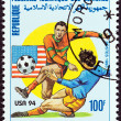 "COMOROS - CIRCA 1993: A stamp printed in Comoros from the ""Football World Cup - U.S.A. 1994 "" issue shows soccer players, circa 1993. — Stock Photo"