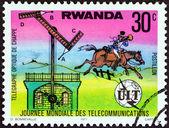 """Ruanda - circa 1977: eine Briefmarke gedruckt in Ruanda aus der """"Welt-Telekommunikation-Tag""""-Ausgabe zeigt die Chappe Semaphor und post Fahrer, ca. 1977. — Stockfoto"""