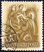 "HUNGARY - CIRCA 1938: A stamp printed in Hungary from the ""900th Anniversary of the Death of St.Stephen "" issue shows St. Stephen offering Crown to Virgin Mary, circa 1938. — Stock Photo"
