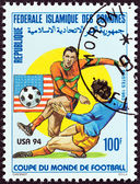 "COMOROS - CIRCA 1993: A stamp printed in Comoros from the ""Football World Cup - U.S.A. 1994 "" issue shows soccer players, circa 1993. — Foto de Stock"
