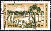 CYPRUS - CIRCA 1962: A stamp printed in Cyprus shows Salamis Gymnasium, circa 1962. — Stockfoto