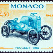 "MONACO - CIRCA 1967: A stamp printed in Monaco from the ""25th Grand Prix, Monaco"" issue shows Peugeot Grand Prix racing car of 1910, circa 1967. — Stock Photo"