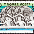 "HUNGARY - CIRCA 1976: A stamp printed in Hungary from the ""Olympic Games, Montreal. Hungarian Medal winners "" issue shows Men's solo kayak and Women's pairs kayak (silver medals), circa 1976. — Stock Photo"