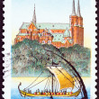 "DENMARK - CIRCA 1998: A stamp printed in Denmark from the ""Millenary of Roskilde "" issue shows Roskilde Cathedral and Viking Longship, circa 1998. — Stock Photo"