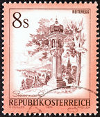 "AUSTRIA - CIRCA 1976: A stamp printed in Austria from the ""Views"" issue shows Votive column, Reiteregg, Styria, circa 1976. — Stock Photo"