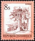 "AUSTRIA - CIRCA 1976: A stamp printed in Austria from the ""Views"" issue shows Votive column, Reiteregg, Styria, circa 1976. — Stock Photo"