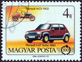 "HUNGARY - CIRCA 1986: A stamp printed in Hungary from the ""Centenary of Motor Car "" issue shows Renault 14 CV, 1902, and Renault 5 GT Turbo, 1985, circa 1986. — Stock Photo"