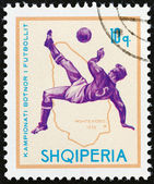 "ALBANIA - CIRCA 1966: A stamp printed in Albania from the ""Football World Cup - England "" issue shows soccer player and map of Uruguay (1930), circa 1966. — Stock Photo"