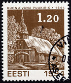 """ESTONIA - CIRCA 1994: A stamp printed in Estonia from the """"Christmas """" issue shows Old Ruhnu wooden church (1644), circa 1994. — Stock Photo"""