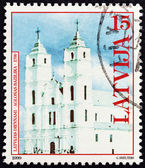 LATVIA - CIRCA 1999: A stamp printed in Latvia shows  Basilica of the Assumption, Aglona, circa 1999. — Stock Photo
