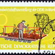 "GERMAN DEMOCRATIC REPUBLIC - CIRCA 1962: A stamp printed in Germany from the ""10th D.D.R. Agricultural Exhibition, Markkleeberg "" issue shows Maize-planting machine, circa 1962. — Stock Photo #47124777"