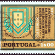 "PORTUGAL - CIRCA 1970: A stamp printed in Portugal from the ""25th Anniversary of the Agricultural Center in Elvas "" issue shows Station Badge, circa 1970. — Stock Photo"