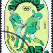 """GRENADA - CIRCA 1976: A stamp printed in Grenada from the """"Olympic Games, Montreal """" issue shows Hockey, circa 1976. — Stock Photo"""