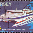 JERSEY - CIRCA 1994: A stamp printed in United Kingdom issued for the 25th anniversary of Jersey Postal Administration shows catamaran Condor 10, circa 1994. — Stock Photo #47766937