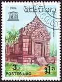 "LAOS - CIRCA 1986: A stamp printed in Laos from the ""40th Anniversary of UNESCO "" issue shows Vat Phou Temple and UNESCO emblem, circa 1986. — Stock Photo"