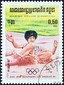 """KAMPUCHEA - CIRCA 1984: A stamp printed in Kampuchea from the """"Olympic Games, Los Angeles"""" 2nd issue shows long jump, circa 1984. — Stock Photo"""