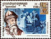 "CAMBODIA - CIRCA 2001: A stamp printed in Cambodia from the ""Millennium "" issue shows Johannes Gutenberg, printers, circa 2001. — Stock Photo"