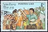 """LAOS - CIRCA 1990: A stamp printed in Laos from the """"New Year"""" issue shows Rice Ceremony, circa 1990. — Stock Photo"""
