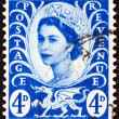 UNITED KINGDOM - CIRCA 1966: A postage stamp printed in United Kingdom shows queen Elizabeth II and Wales emblem, circa 1966. — Stock Photo #48073377