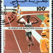 Постер, плакат: DJIBOUTI CIRCA 1985: A stamp printed in Djibouti issued for the 1st Marathon World Cup Hiroshima shows finishing line and officials circa 1985