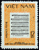 VIETNAM - CIRCA 1980: A stamp printed in North Vietnam shows National Anthem, circa 1980. — Stock Photo