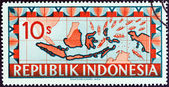 INDONESIA - CIRCA 1949: A stamp printed in Indonesia shows map of Indonesia with ships representing blockade runners streaming toward the Republic of Indonesia, circa 1949. — Stock Photo