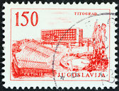 YUGOSLAVIA - CIRCA 1961: A stamp printed in Yugoslavia shows Titograd Hotel, circa 1961. — Stock Photo