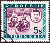 INDONESIA - CIRCA 1947: A stamp printed in Indonesia shows Motorized police, Ali Sastroamidjojo (1903-1976), circa 1947. — Stok fotoğraf