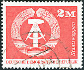 GERMAN DEMOCRATIC REPUBLIC - CIRCA 1973: A stamp printed in Germany shows Coat of Arms, circa 1973. — Stock Photo