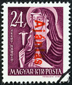 HUNGARY - CIRCA 1946: A stamp printed in Hungary shows St. Margaret, circa 1946. — Stock fotografie