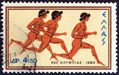 """GREECE - CIRCA 1960: A stamp printed in Greece from the """"Olympic Games, Rome"""" issue shows sprinting, circa 1960. — Stock Photo"""