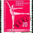 "GERMAN DEMOCRATIC REPUBLIC - CIRCA 1961: A stamp printed in Germany from the ""3rd European Women's Gymnastic Championships, Leipzig "" issue shows gymnast, circa 1961. — Stock Photo #50042499"