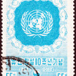 SOUTH KOREA - CIRCA 1955: A stamp printed in South Korea issued for the 10th anniversary of United Nations shows emblem, circa 1955. — Stock Photo #50043317